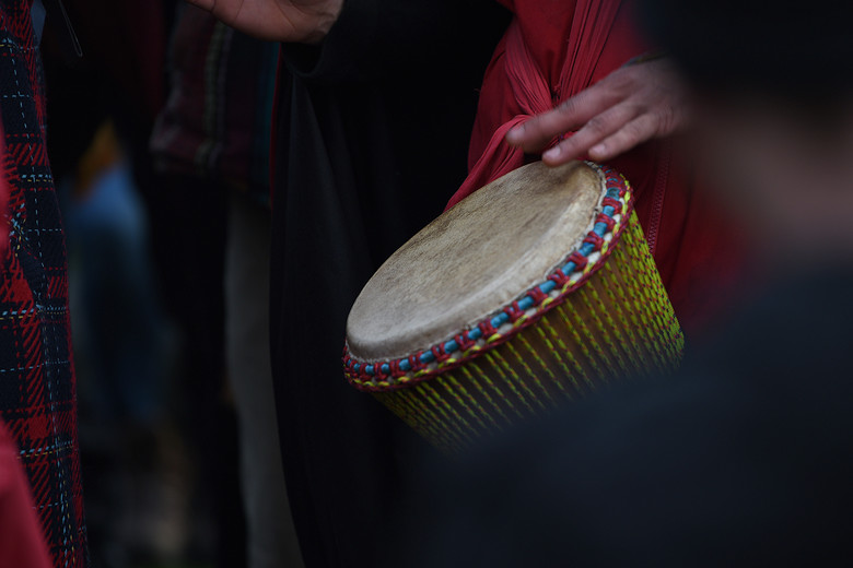 A man plays a drum during covid